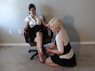lesbian reading a book while worshiping her feet